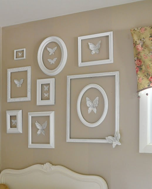 i adore the book page butterflies accented inside the empty frames just gorgeous she painted all of the garage sale pictures accumulated over the years