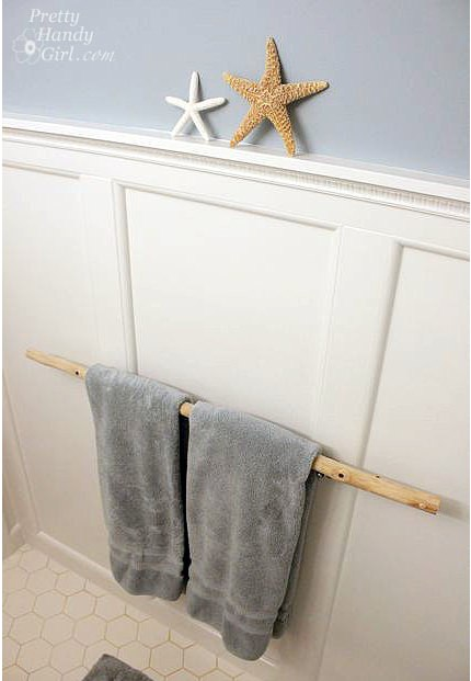 11 beautiful ways to display bathroom towels tip junkie for How to tie towels in bathroom